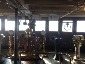 On the bridge. Who is at the helm?