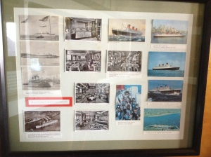 The QM in postcards displayed on board.