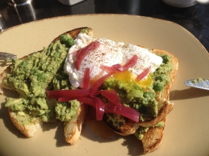 avocado, peas and mint on toast with poached eggs. A little bit eaten, sorry, the pic was an after-thought.